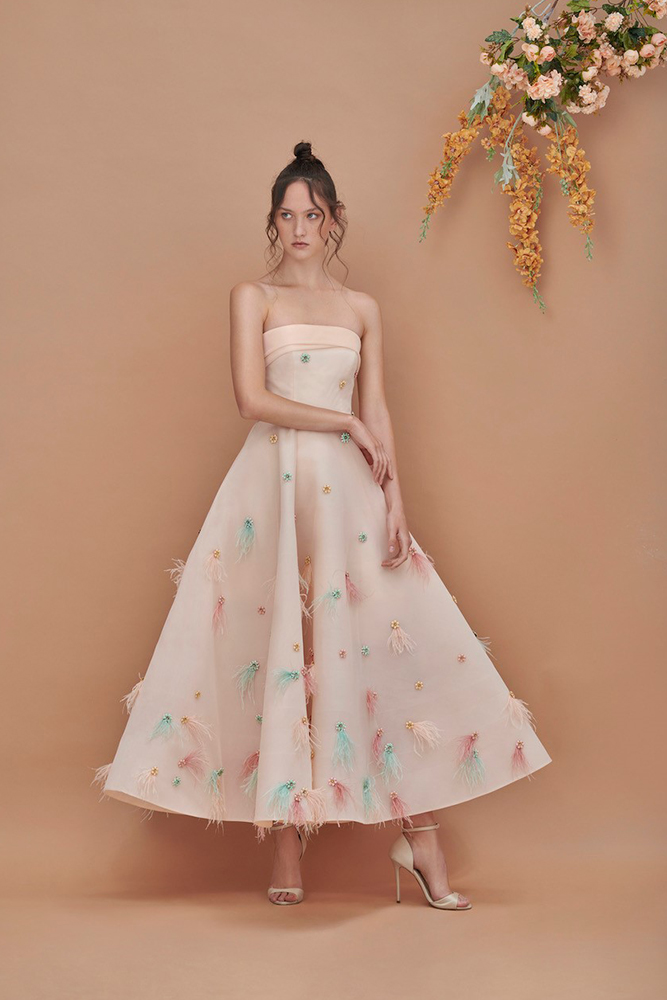 Feather embellsihed volume gown