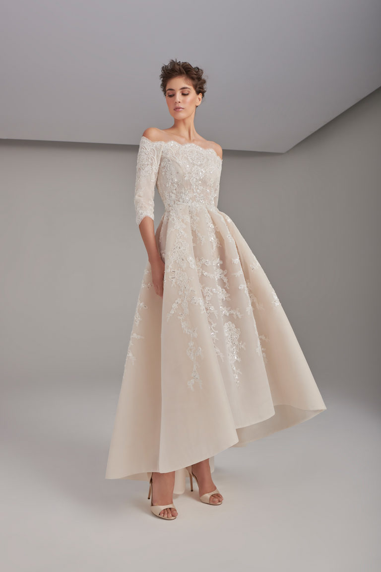 Lace embroidered box-pleated gown